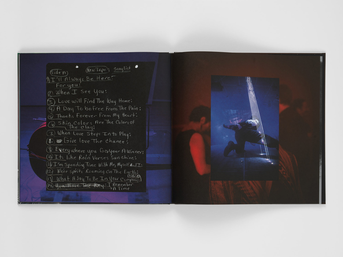 Interior spread of a book by Jacolby Satterwhite. Left-hand page is the song list. Right is a photo of him performing.