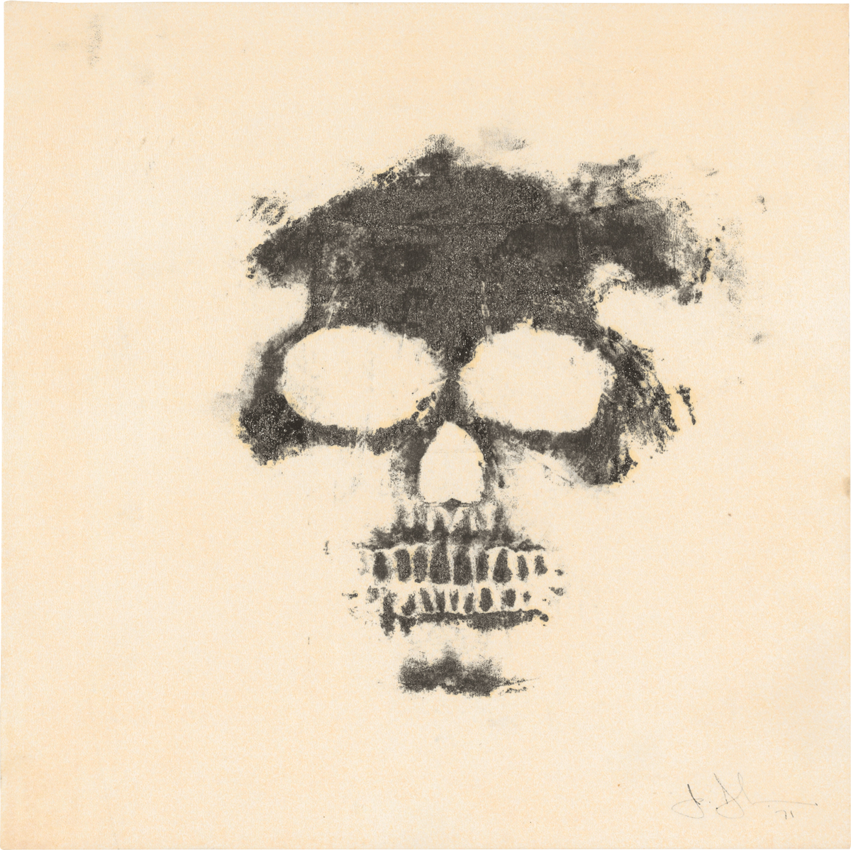 A somewhat incomplete black etching of a skull on creme papaer.