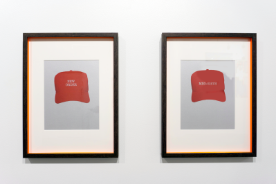 """Two framed images depict red MAGA-style hats embroidered with the words """"New Order"""" and """"Megadeth."""""""