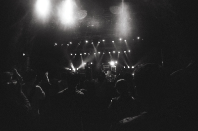 A grainy black-and-white photo of a concert.