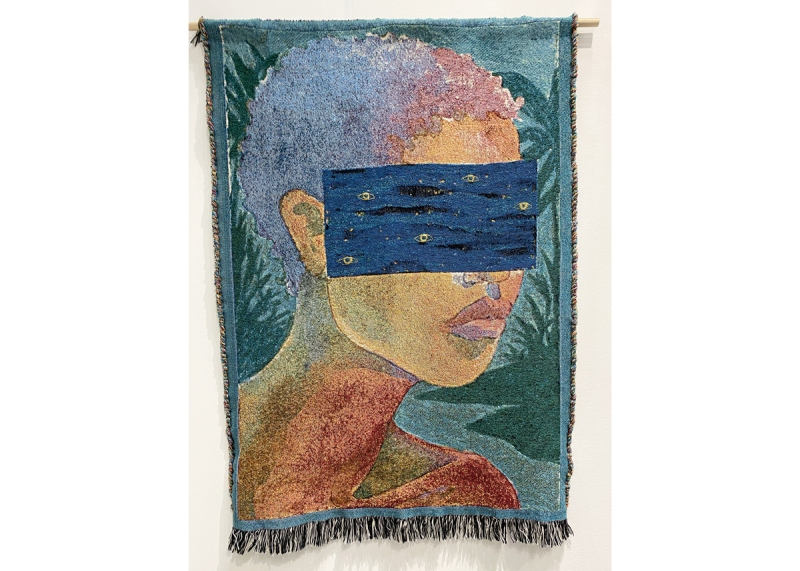 A tapestry showing a woman whose eyes are covered by a blue box of waves with small gold eyes.