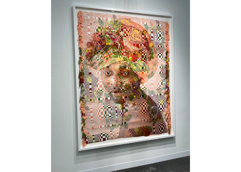 A fabric and photography woven portrait of a man in a head wrap.