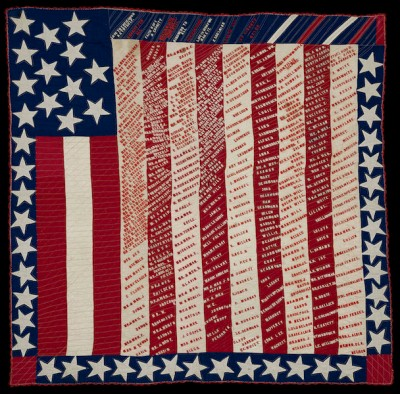 A square altered stars-and-stripes quilt, with its stripes running vertically and its stars distributed around the periphery, is emblazoned with the names of myriad individuals..