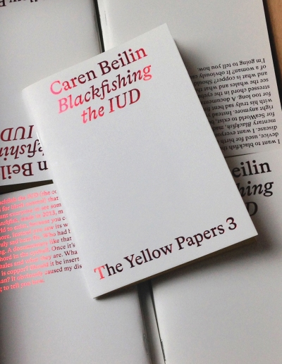 A white book with shiny red text says Craen Beilin Blackfishing the IUD.