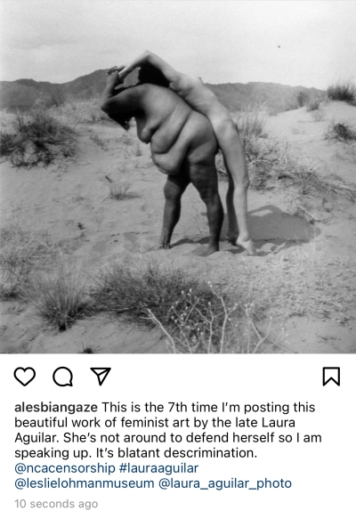 Screenshot of a Laura Aguilar photograph posted to Instagram. In the photograph a large-bodied woman lifts another one in a desert landscape